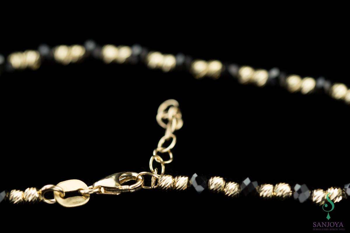 Geel gouden armbandje van 18Kt met onyx
