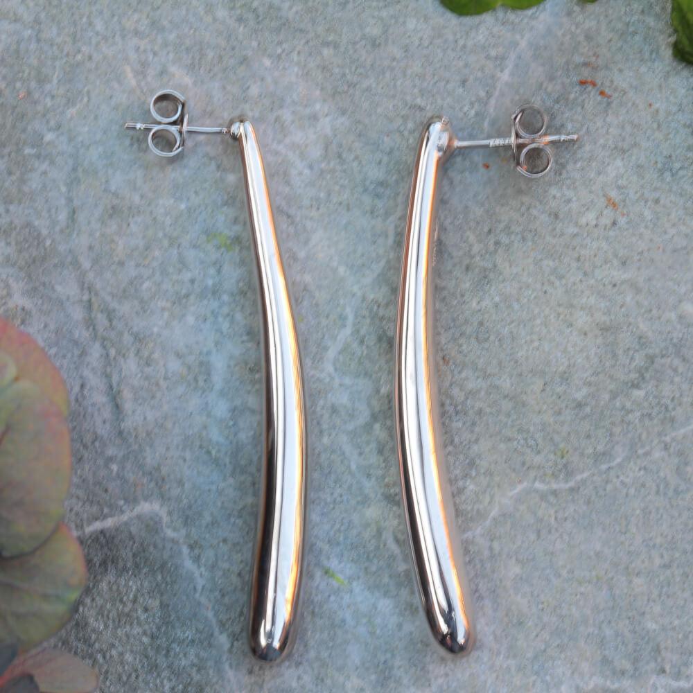 Zilver gepolijste lange oorbellen