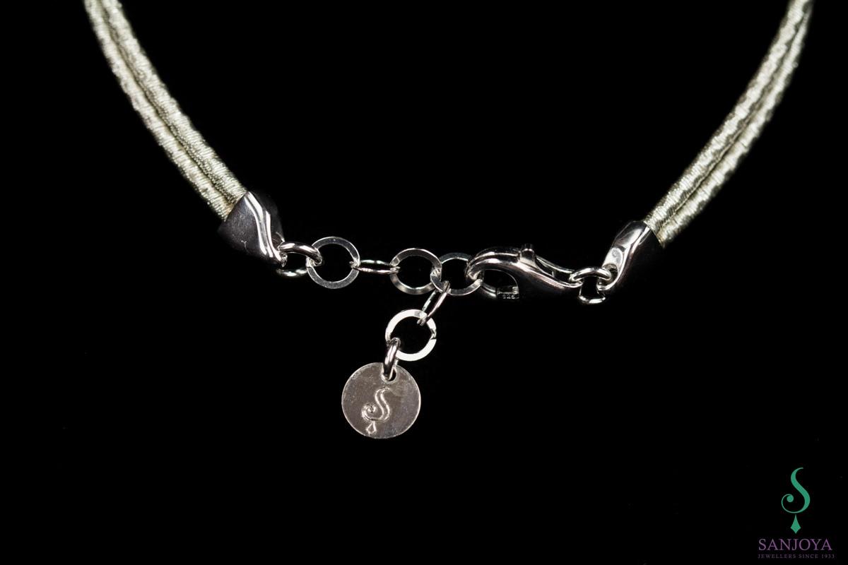 Verfijnd wit zilveren armbandje met knoop, 2mm