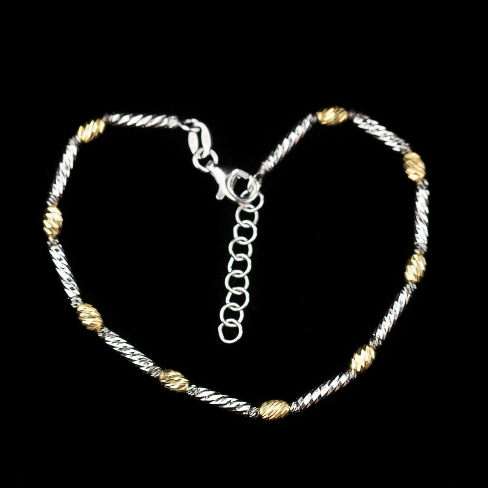 Italiaans 3 kleurig armbandje in goud, zwart en zilver