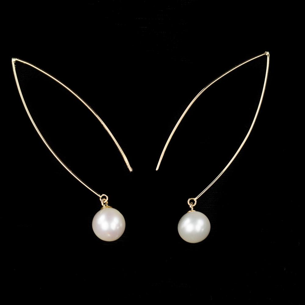 18Kt gouden en lange oorbellen met een parel