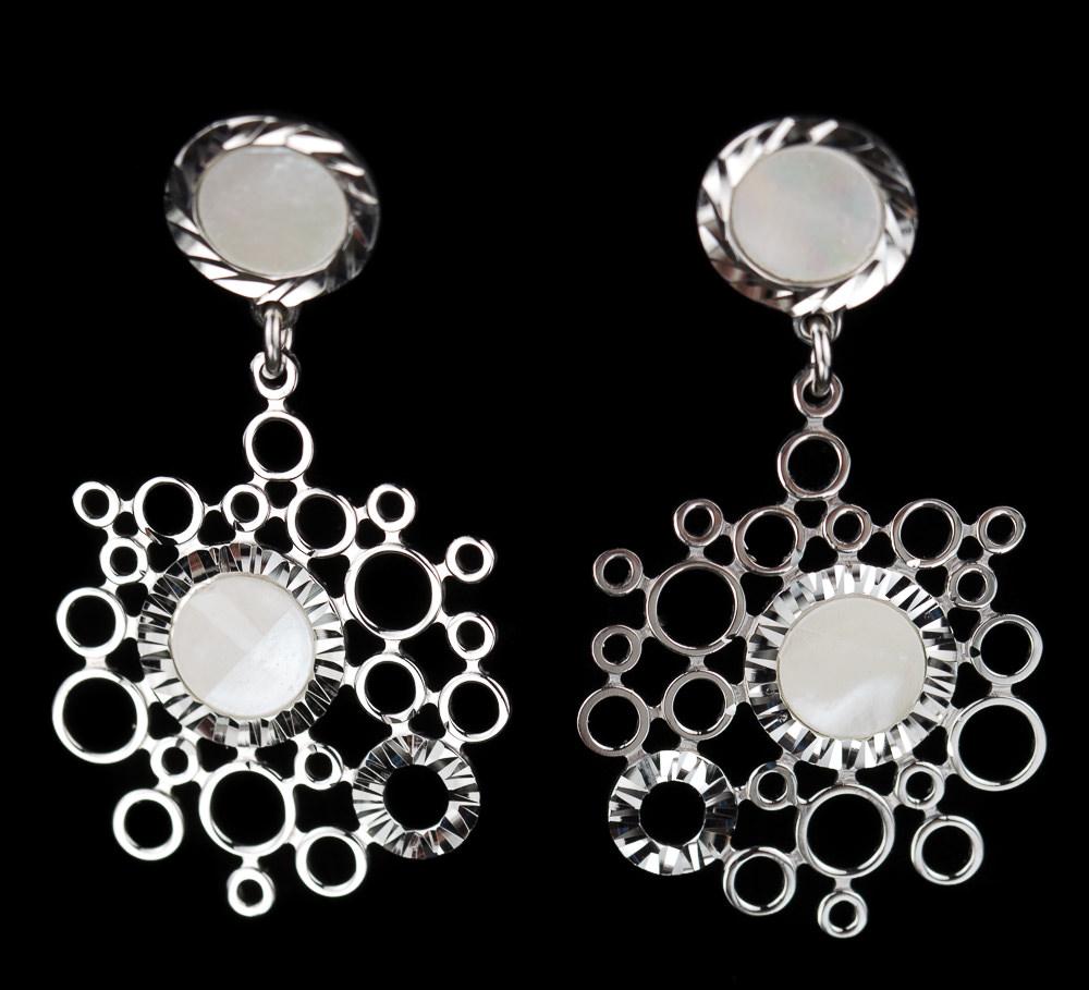 Zilveren oorbellen met cirkeltjes van parelmoer