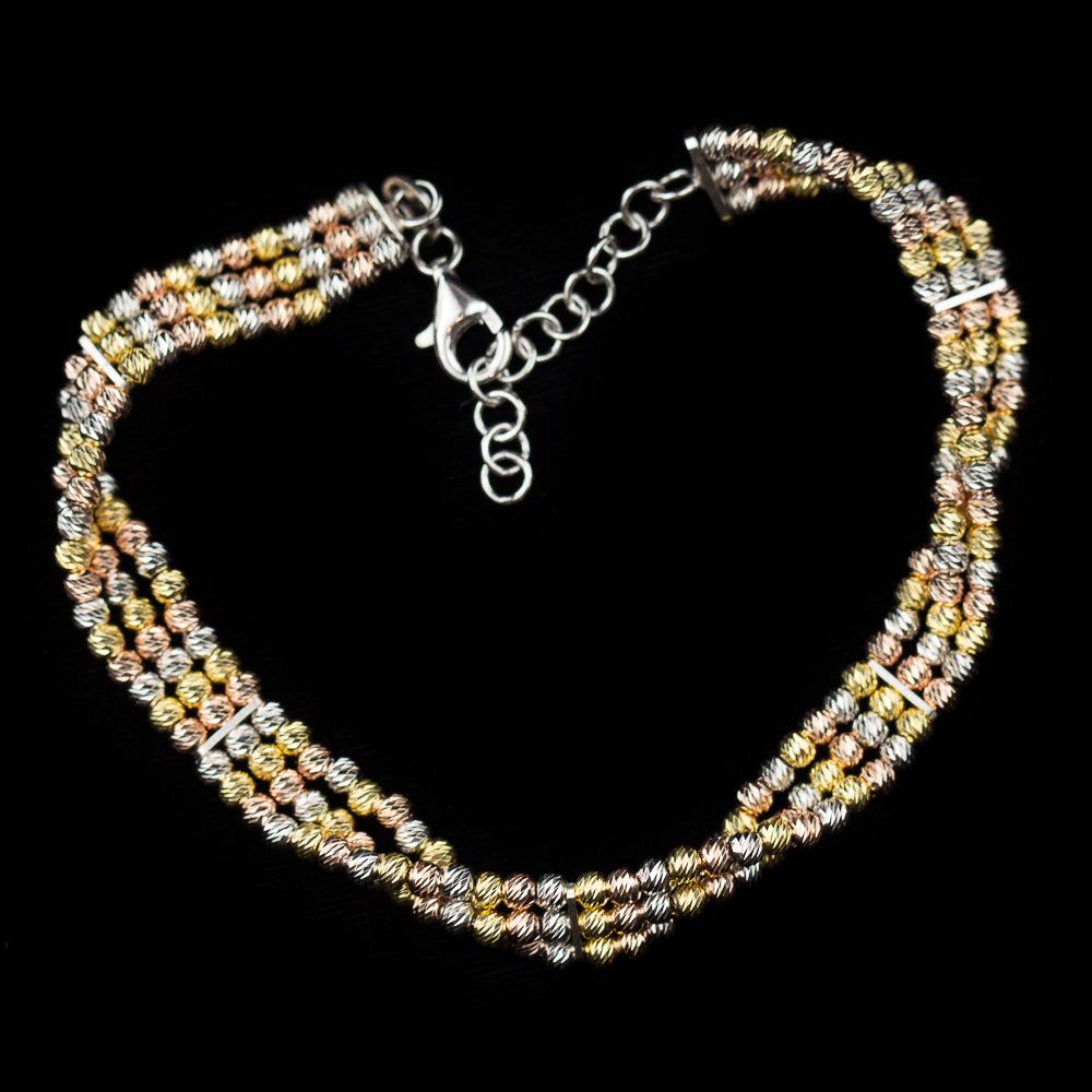 Verfijnde armband van drie rijen zilver, rosé en verguld