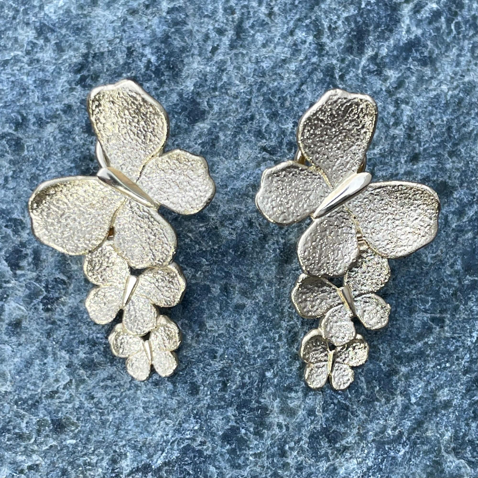 Vergulde eye catcher vlinder oorbellen
