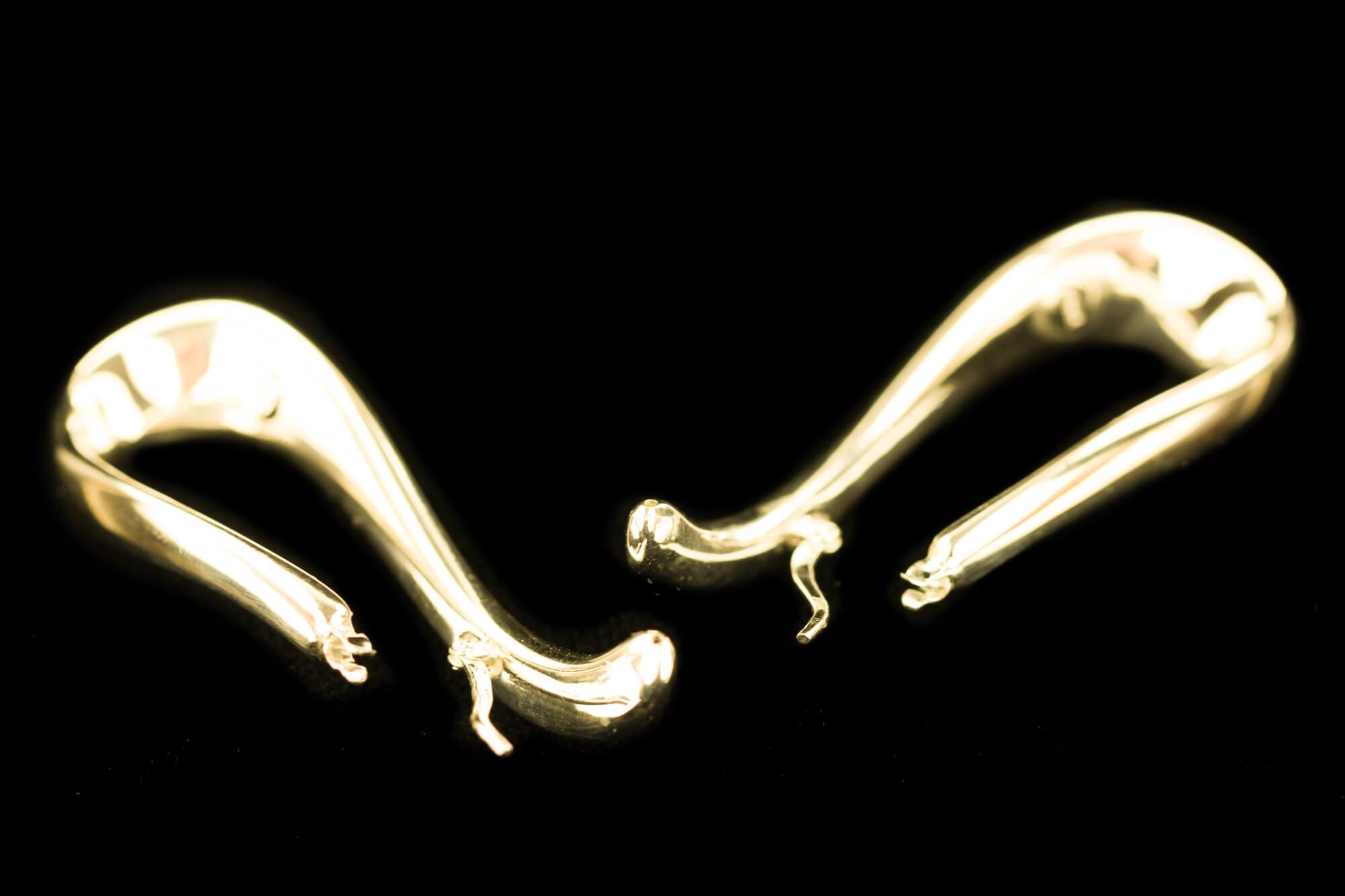 Vergulde en gepolijste infinity créolen
