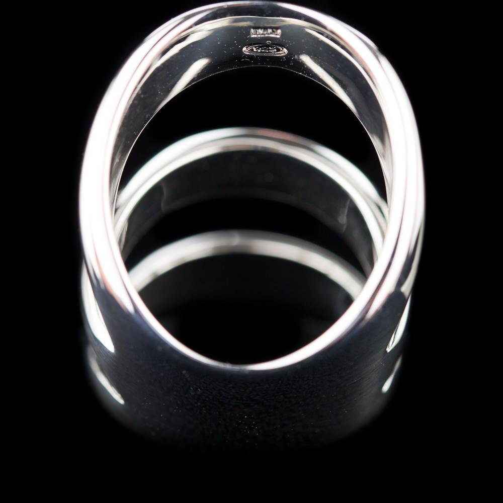 Zilveren ring, blinkend en drie rijen