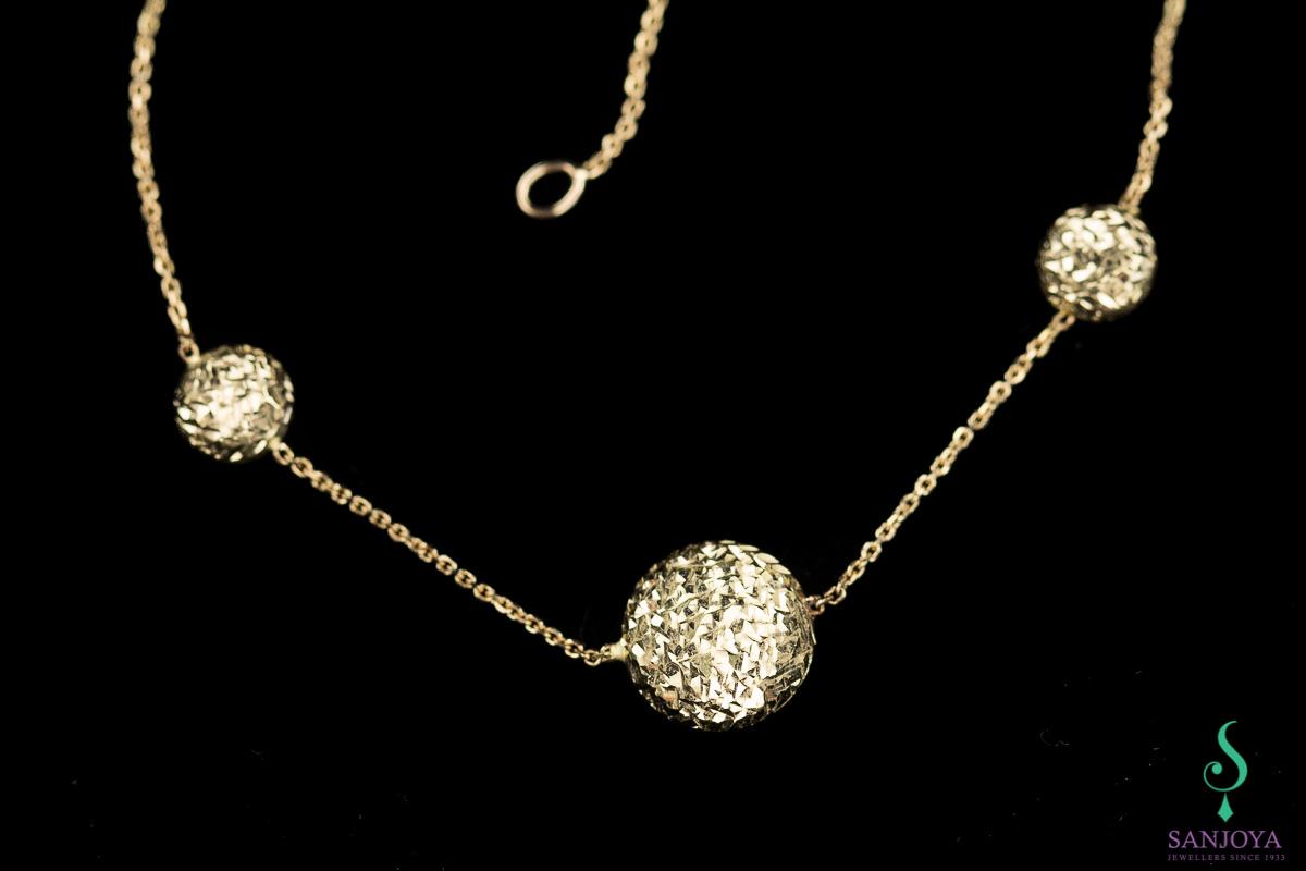 Gouden armbandje van 18Kt met schitterende versiering