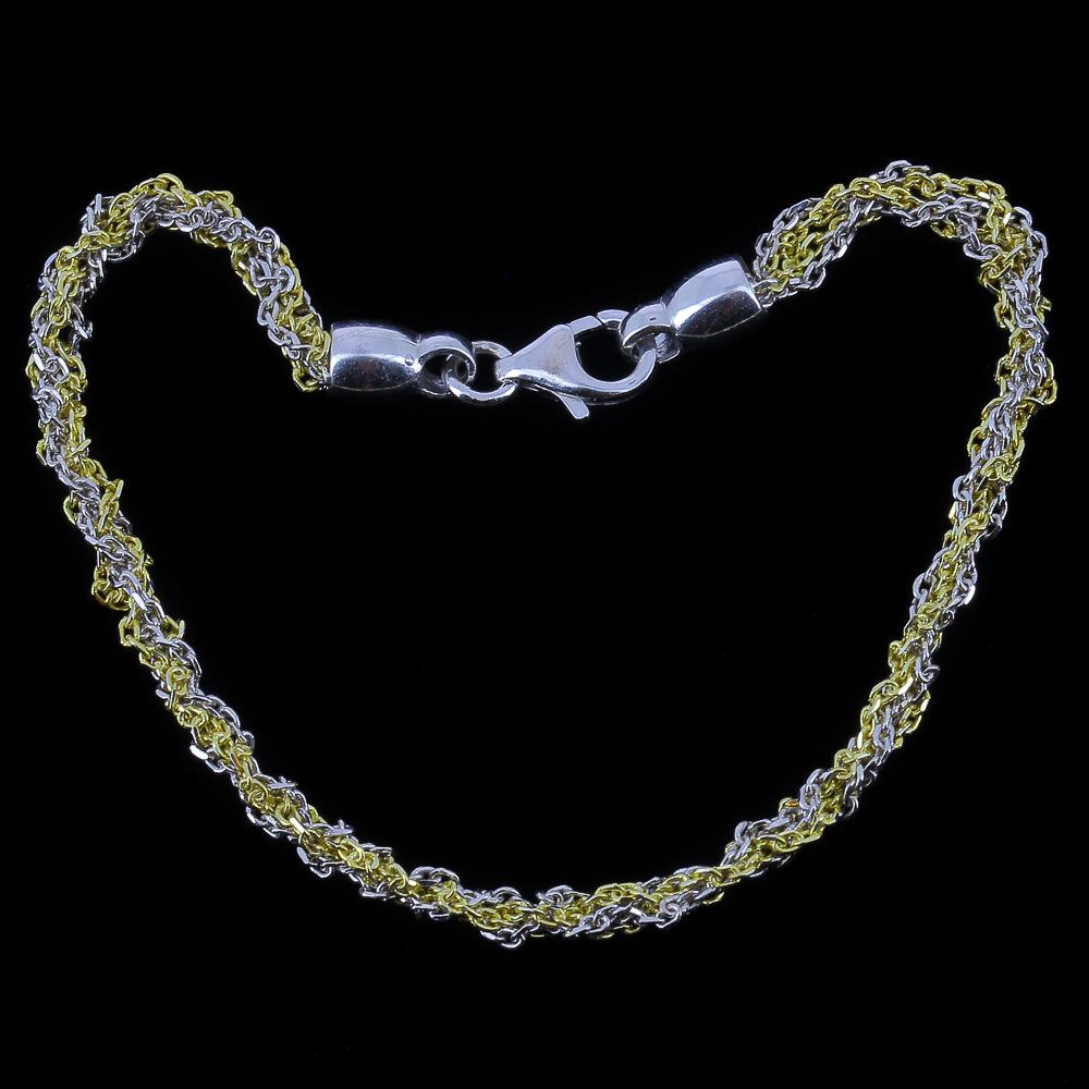 Tweekleurige verweven armband van zilver en verguld