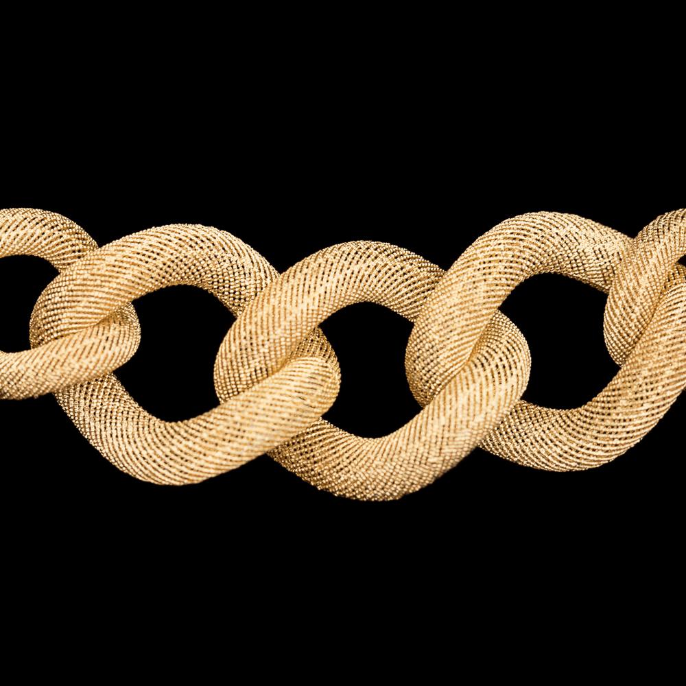 Goudkleurig schakelcollier met subliem transparant patroon