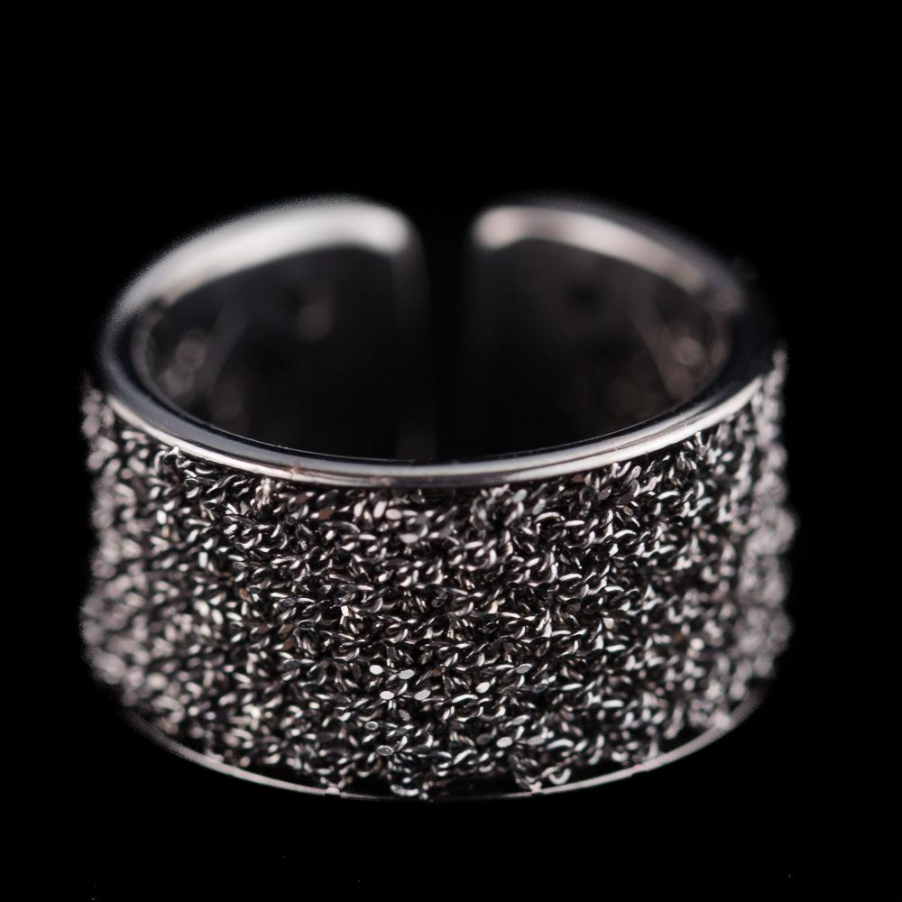 Bijzondere open ring van verweven zwart zilver