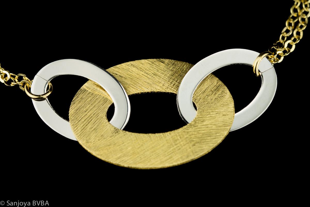 Vergulde en zilveren schakelarmband